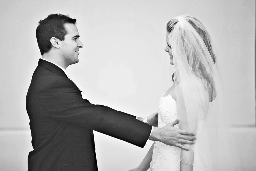 Bride and groom first look at each other before their wedding ceremony. Black and white photography