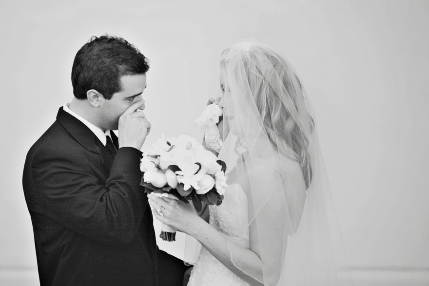 Bride and groom first look at each other and begin crying before their wedding ceremony