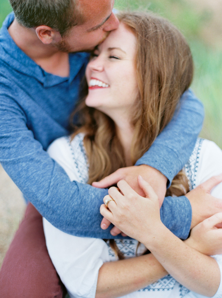 Sweet embrace of an engaged couple in love shoot