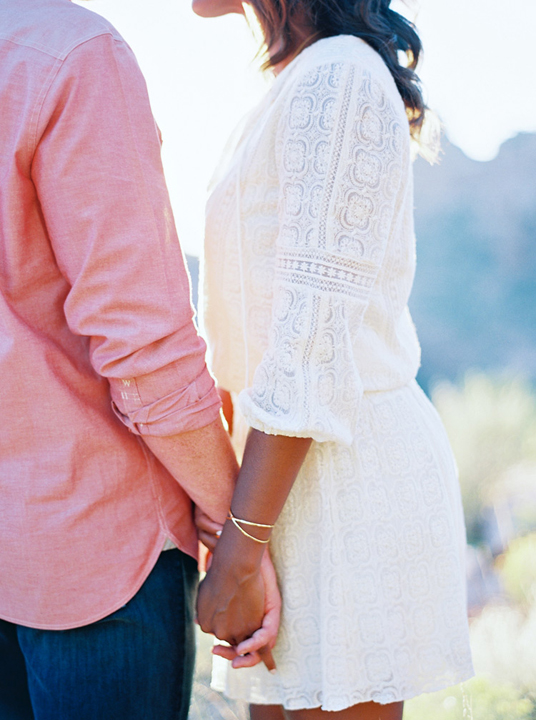 Sedona engagement shoot. Cotton lace dress for her, pink oxford shirt and jeans for him.