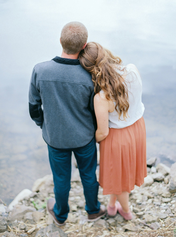 Couple facing Lakeside, Colorado embracing one another