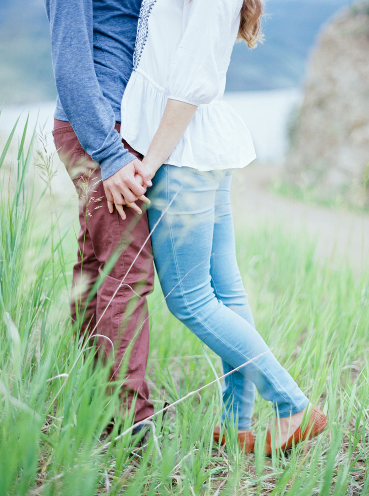Holding hands in the green fields of Colorado Rockies