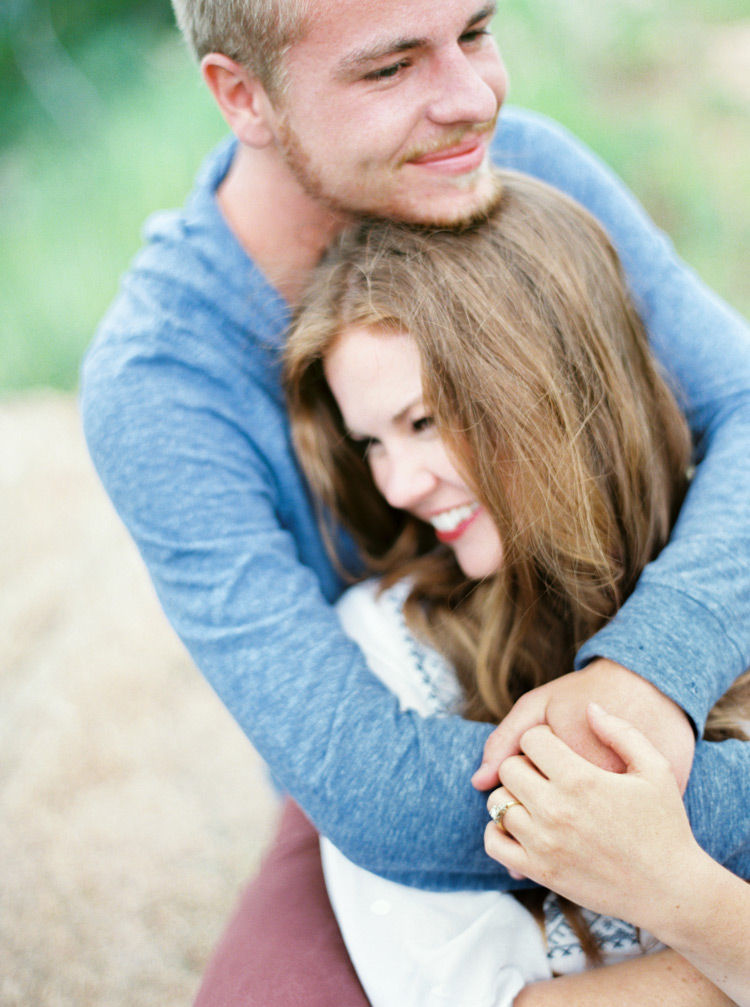 Personal embrace of engaged couple outdoor session in Colorado