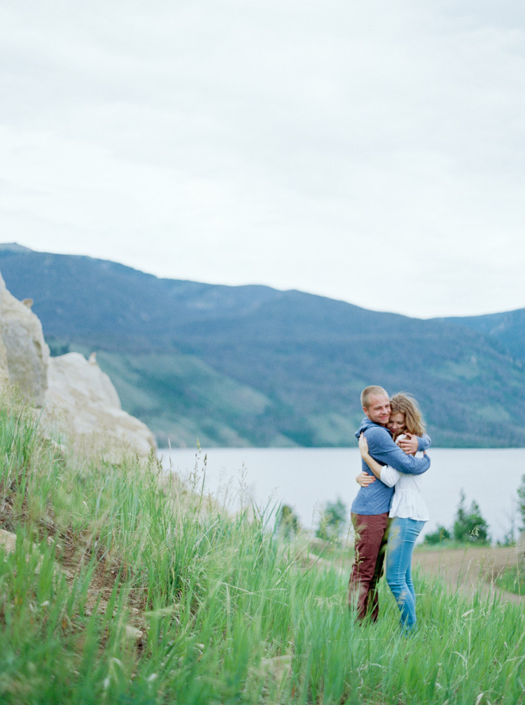 In love engaged couple hugging in open fields Rocky, Colorado