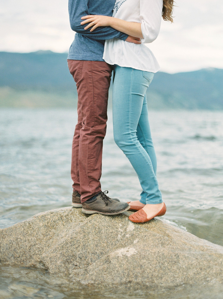 Couple held closely on rock in Colorado lake