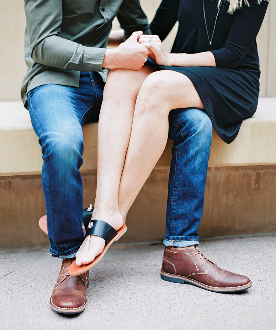 brown shoes for him; sandals for her