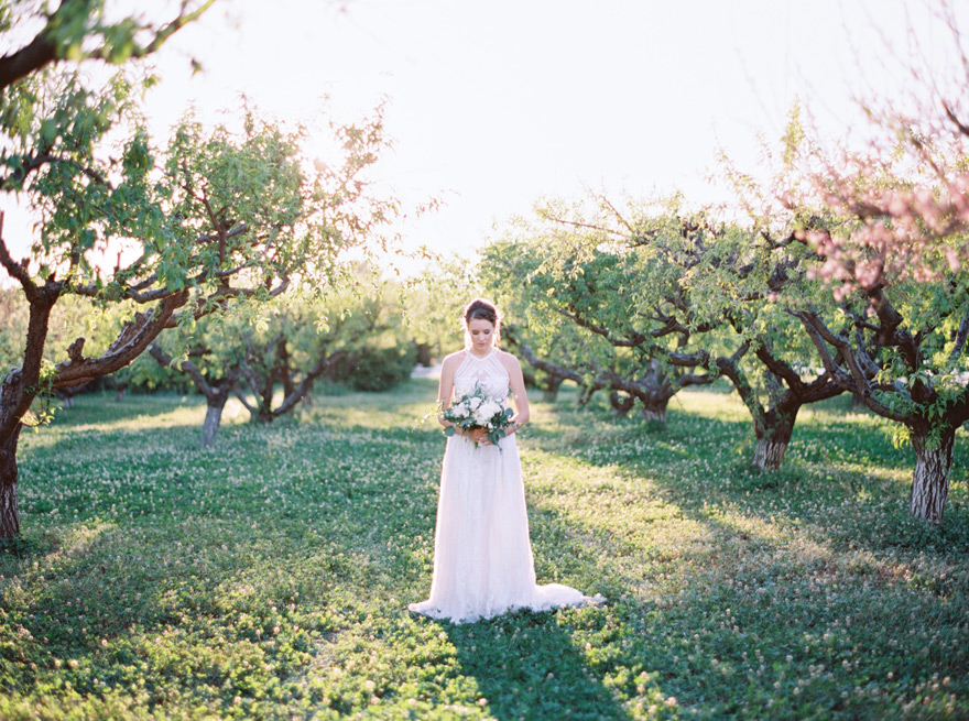 bride in The Farm at Agritopia orchard