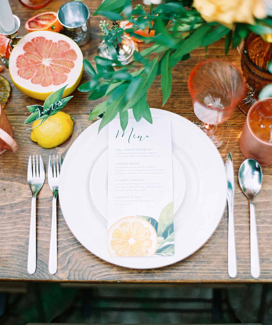 citrus themed wedding reception table setting
