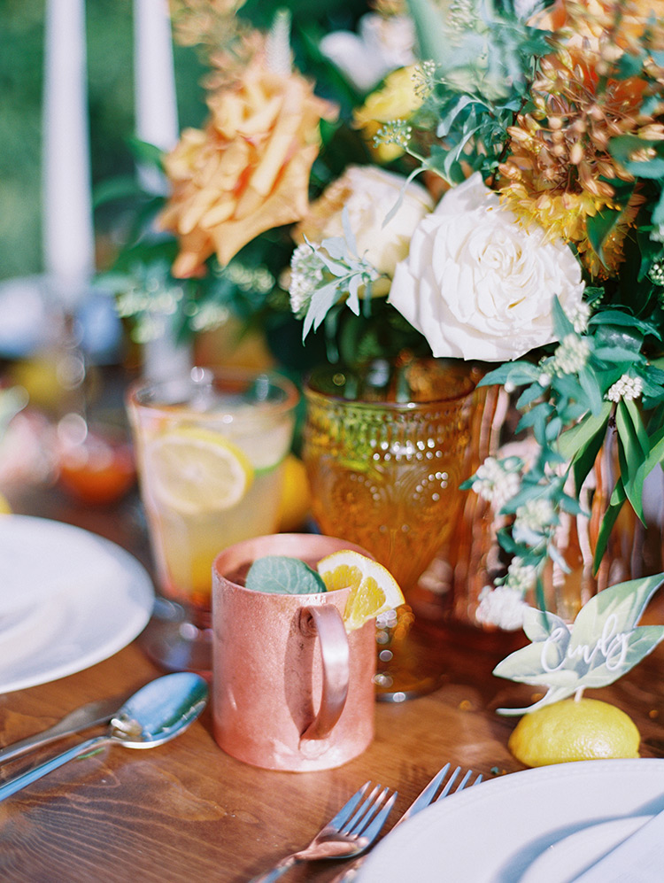 citrus themed wedding reception in an orchard