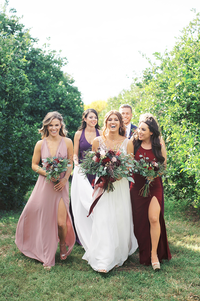 bridesmaids in wine-tones