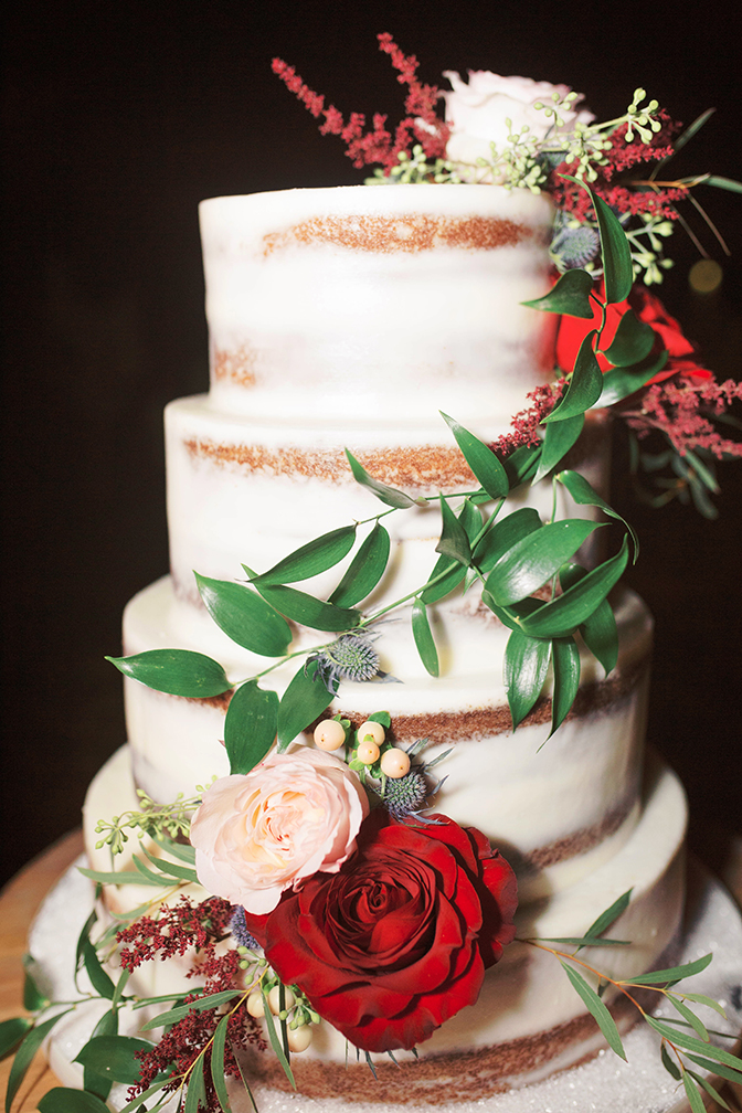 nearly naked wedding cake with fresh flowers