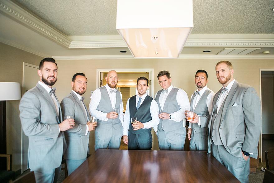 dapper groomsmen in gray