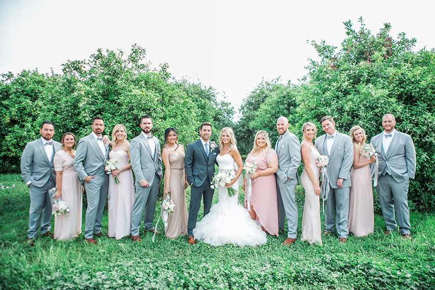 stylish bridal party in the orchard at The Farm at Agritopia
