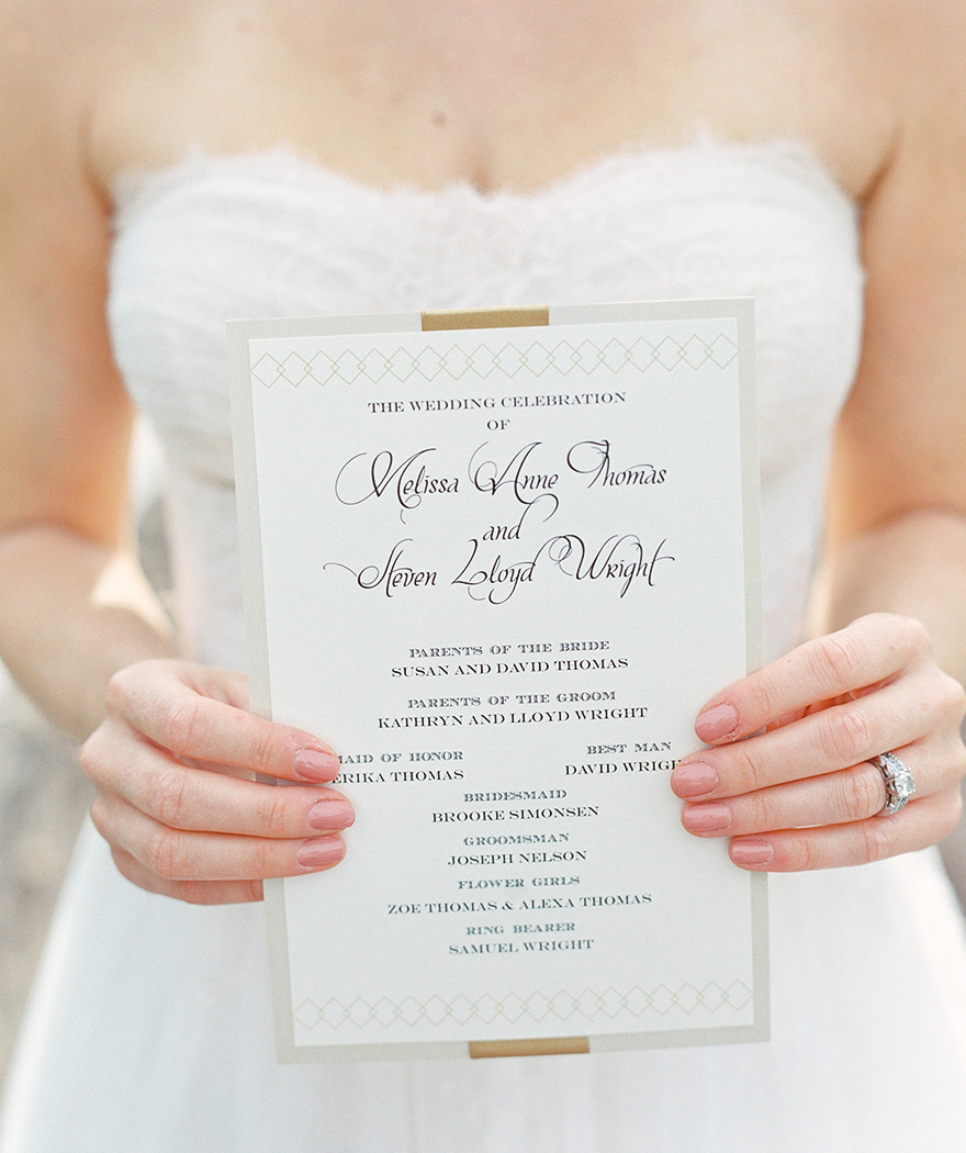 A modern, refined wedding program for a white and gold wedding.