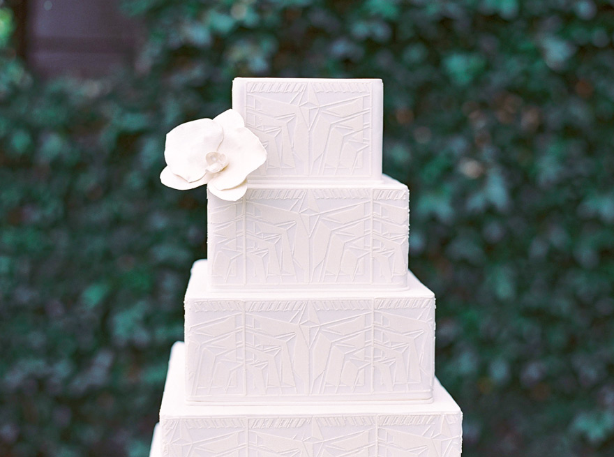 White-on-white architectural wedding cake inspired by Frank Lloyd Wright.