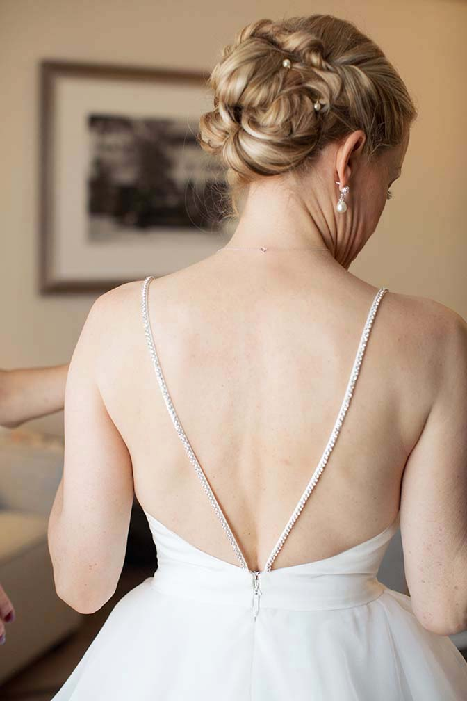 unique crystal straps on a ballgown from Mikaella by Paloma Blanca