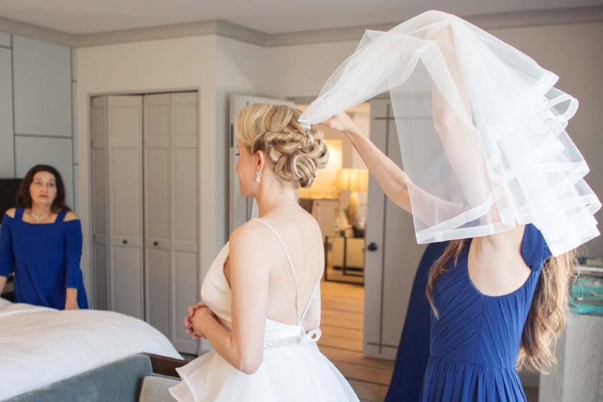 bride donning her veil