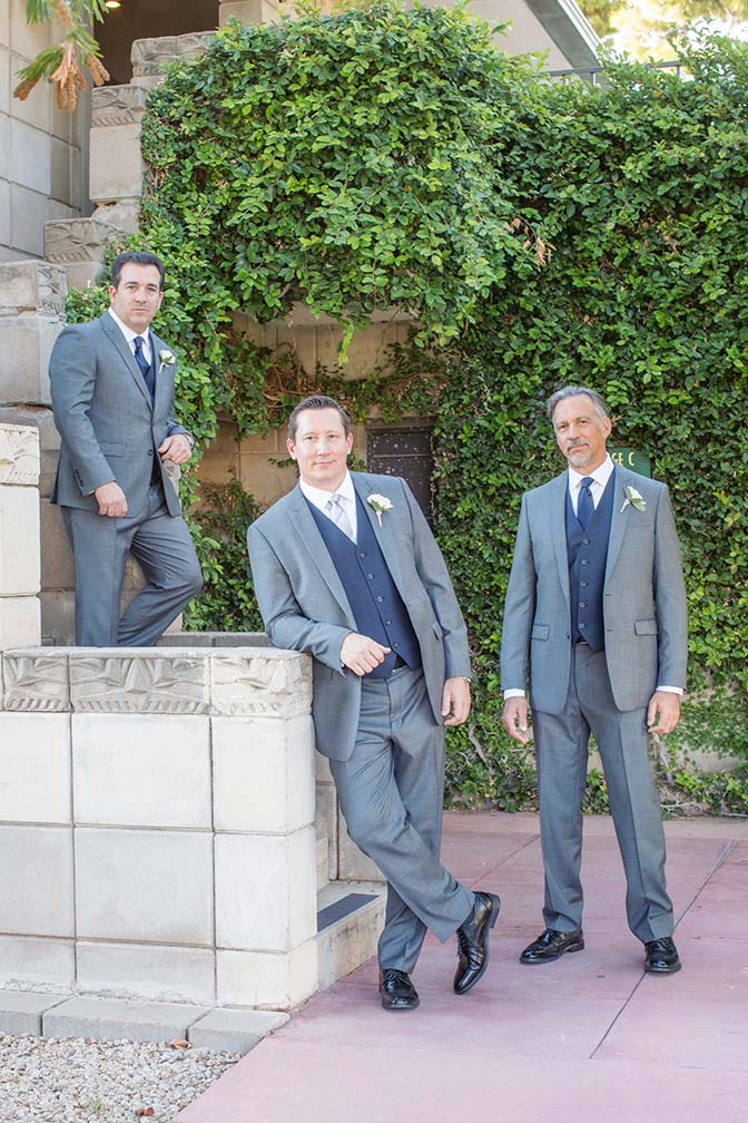 groomsmen in stylish gray & blue three-piece suits