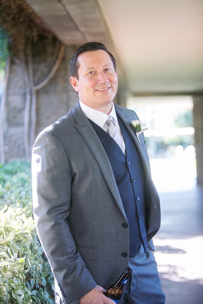 groom in a stylish three-piece suit
