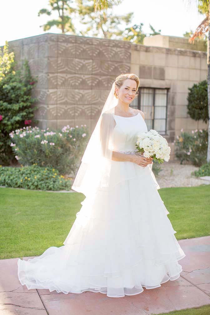 bride in a layered ballgown from Mikaella  by Paloma Blanca