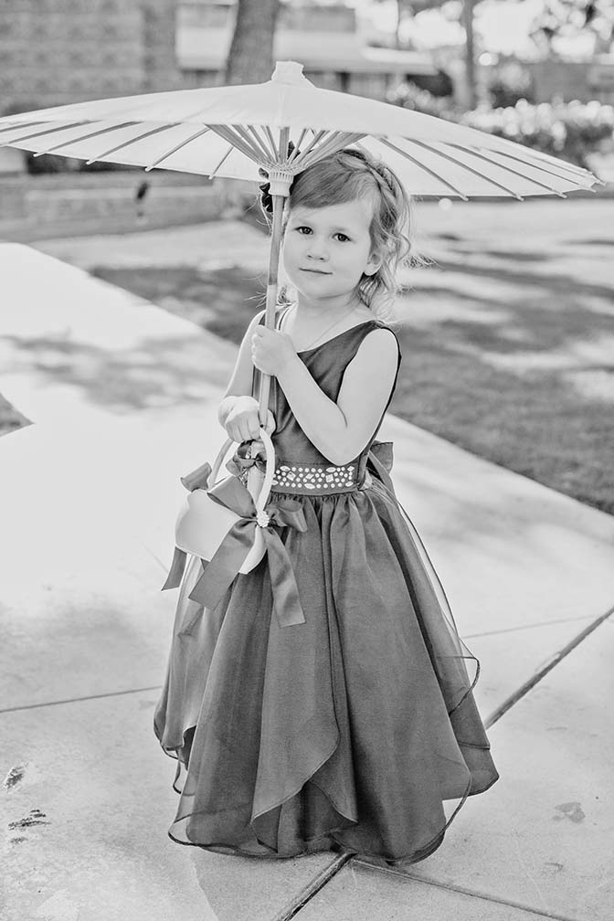 adorable flower girl with a parasol