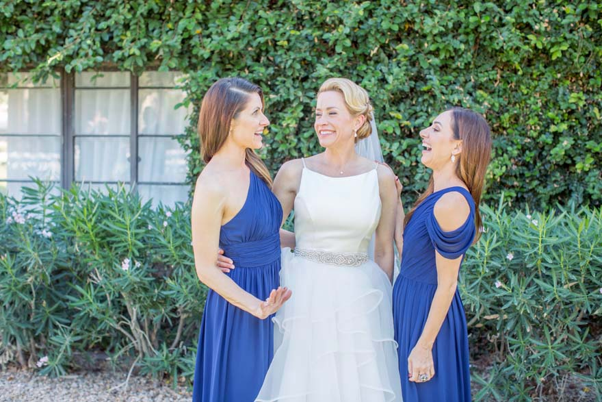 laughing bridesmaids in blue