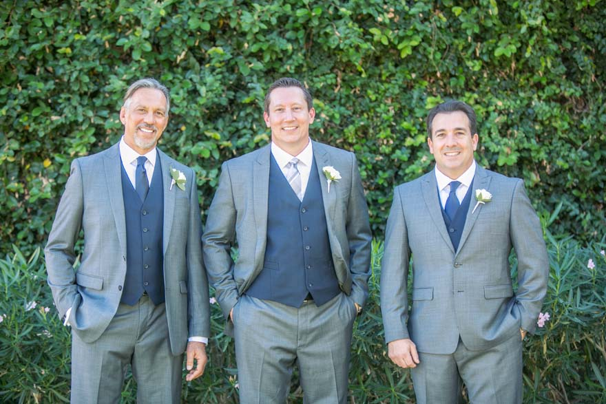 Groom & groomsmen in three-piece suits