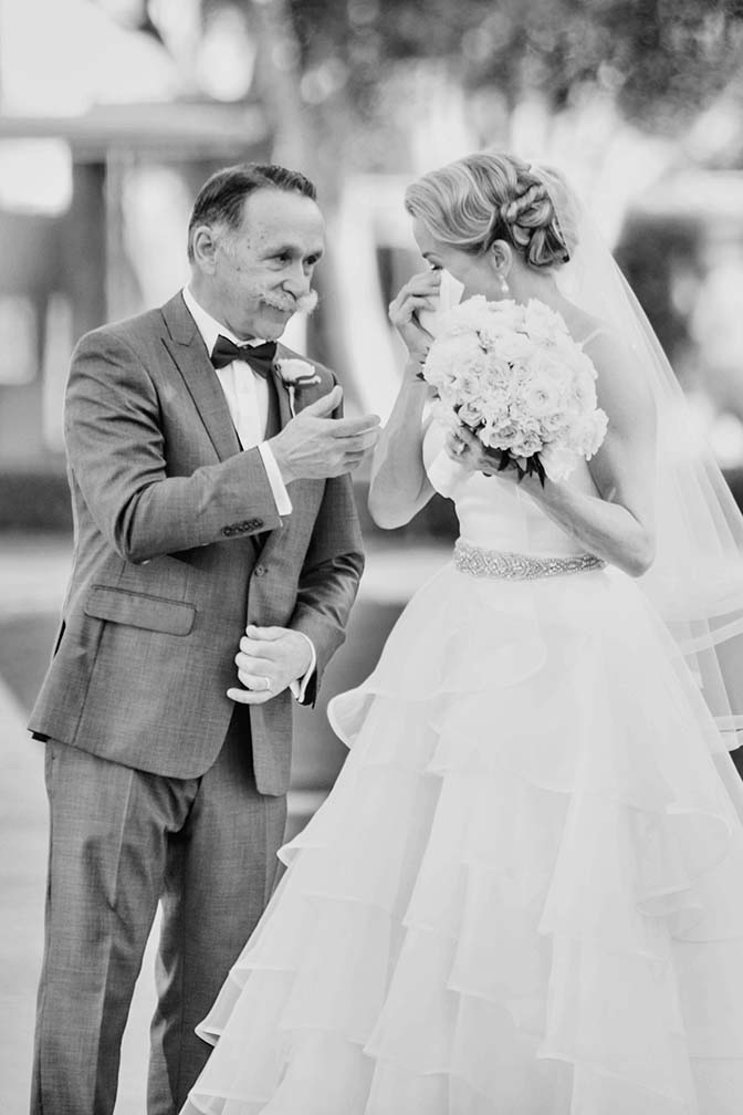 father-of-the-bride shares his handkerchief