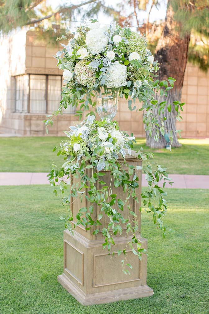 elegant arrangement of white flowers & lavish greenery