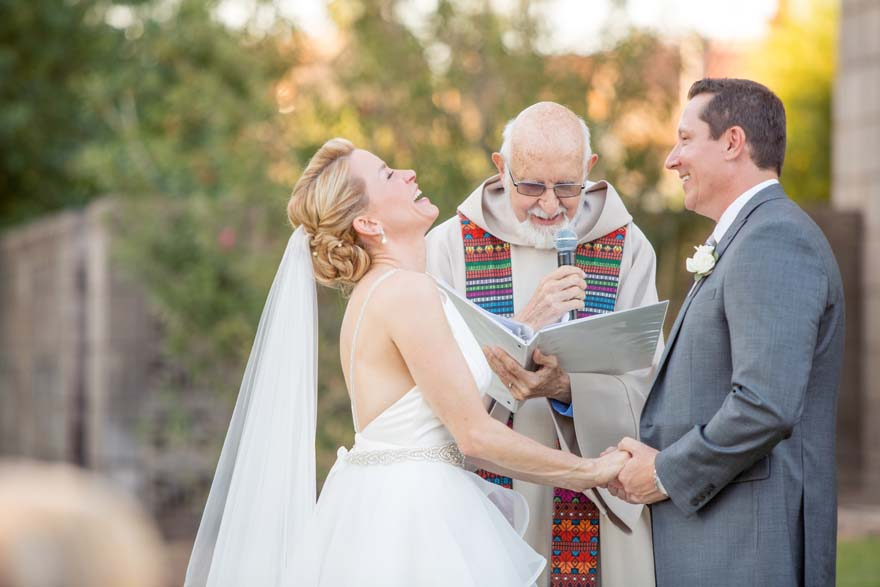 Bride laughs happily during the wedding