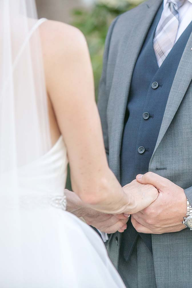 clasping hands and exchanging vows