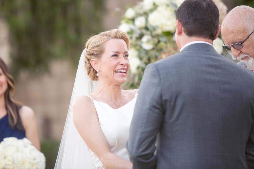 bride laughs as she hears her groom's vows