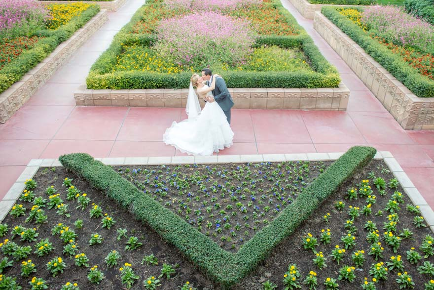wedding embrace among the flower beds at the Arizona Biltmore