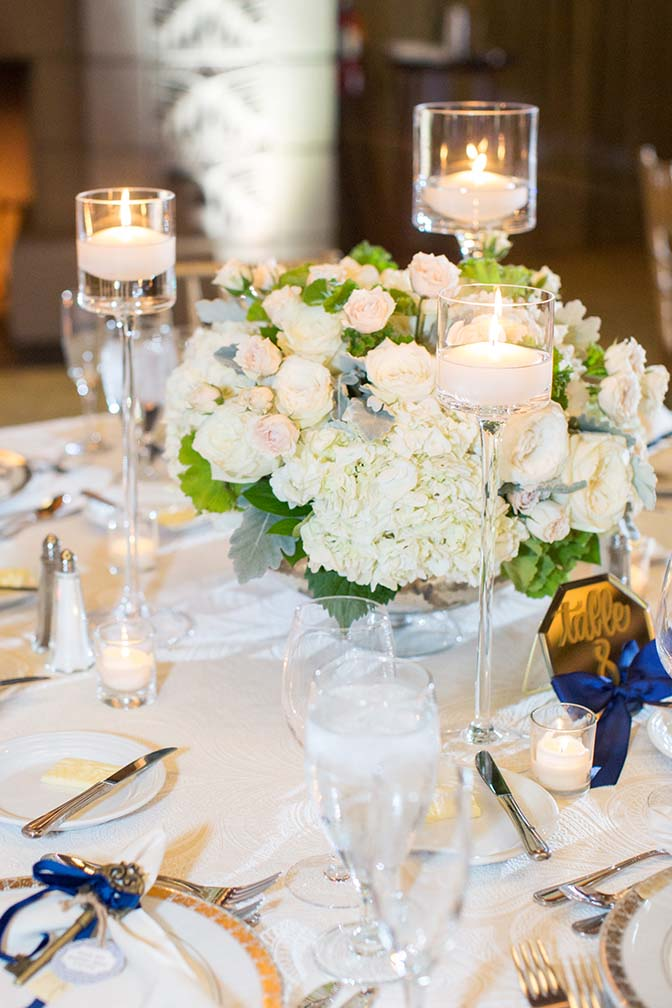 lace tablecloth and pale flowers at a candlelight reception