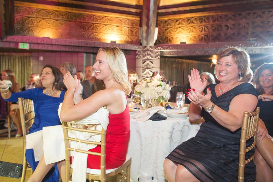 guests laugh during the wedding reception