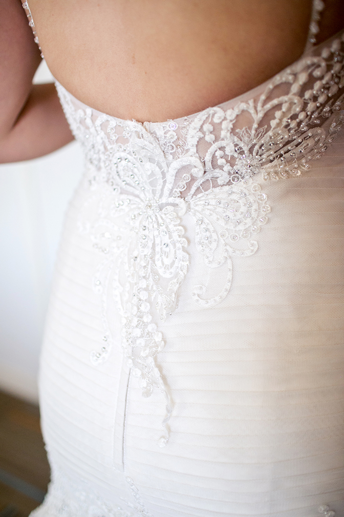 beaded lace detailing on a wedding dress