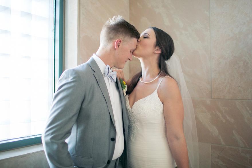 sweet kiss between the bride & groom