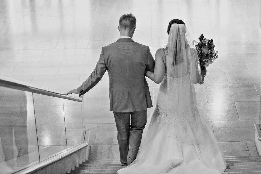 bride & groom descend a staircase