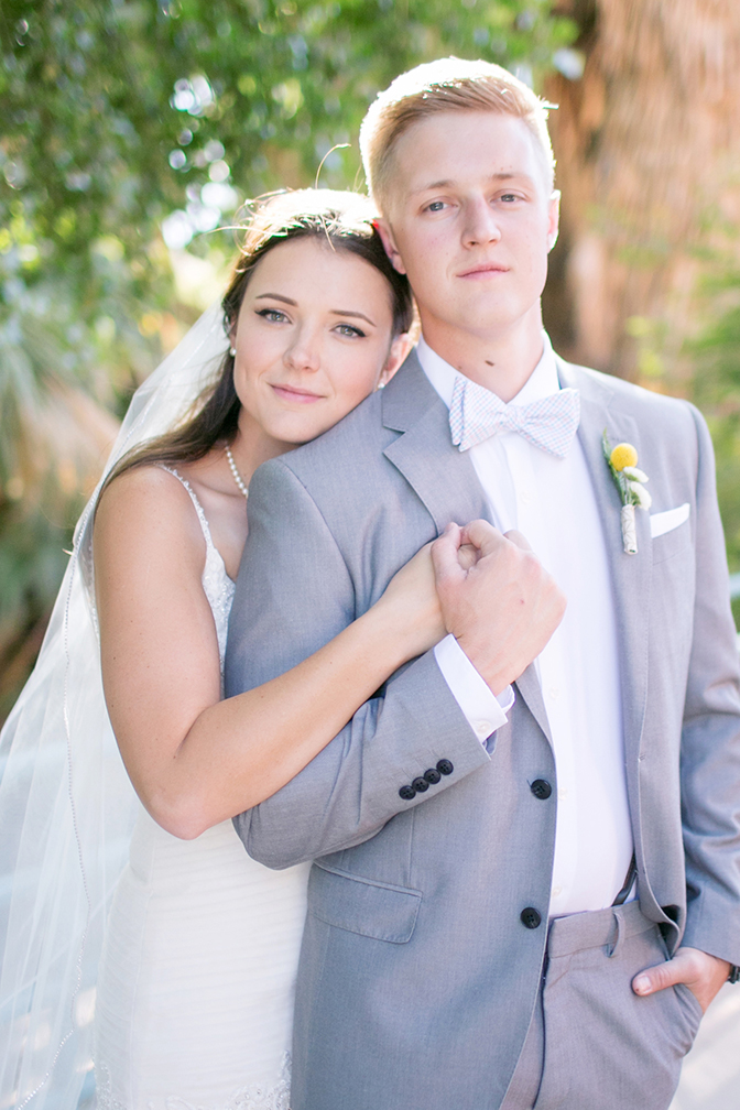 smiling bride & groom with dapper, rustic style