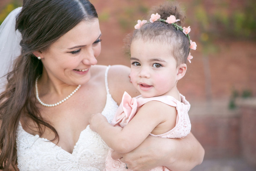 Bride laughing with her baby niece before the wedding