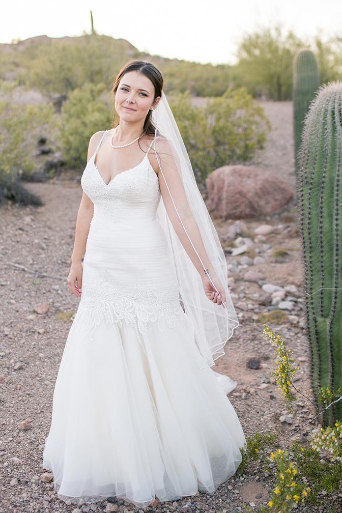 desert bride in a romantic wedding dress