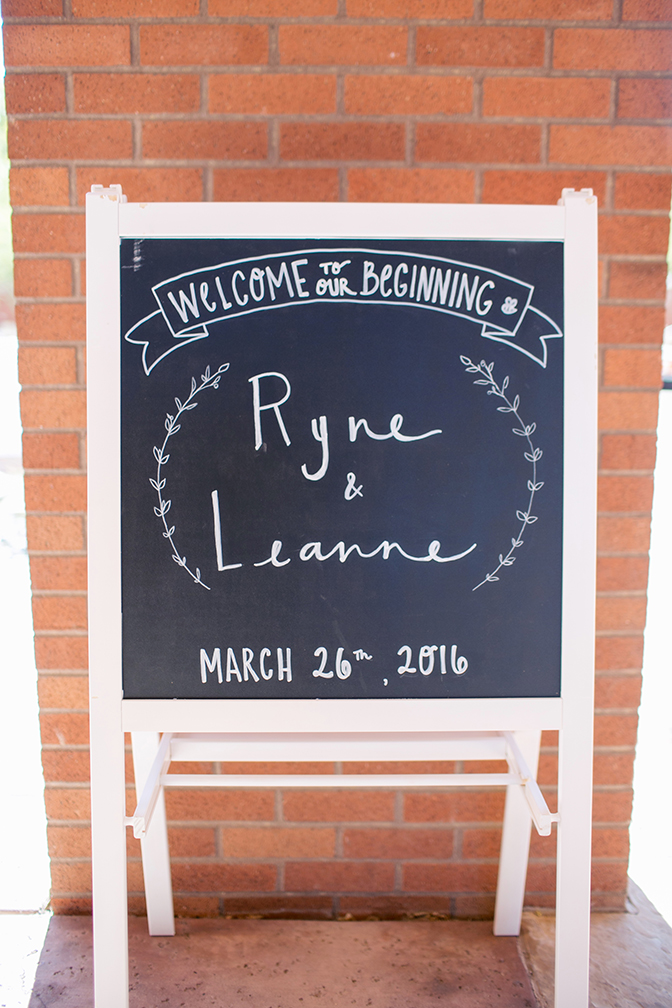 rustic chalkboard sign announces the wedding