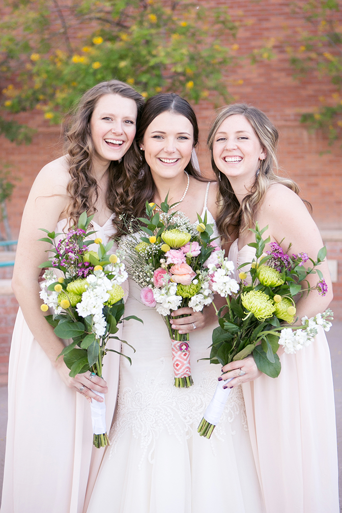 bridesmaids in blush with rustic bouquets