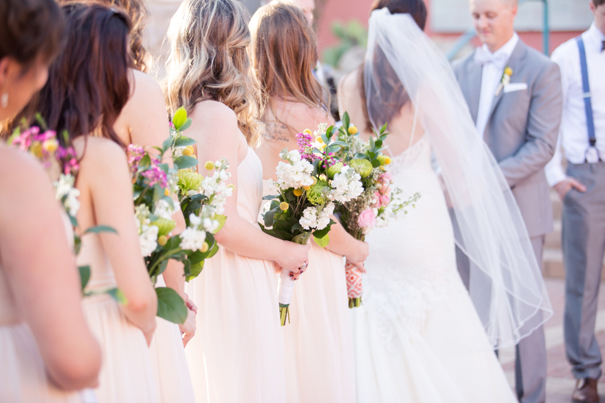 bridesmaids in blush watch the vows