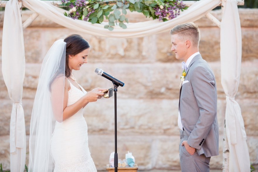 exchanging vows in an outdoor wedding ceremony