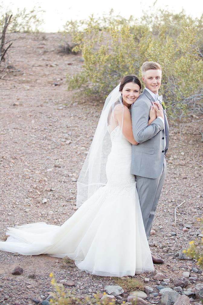 bride & groom embrace in the Arizona desert