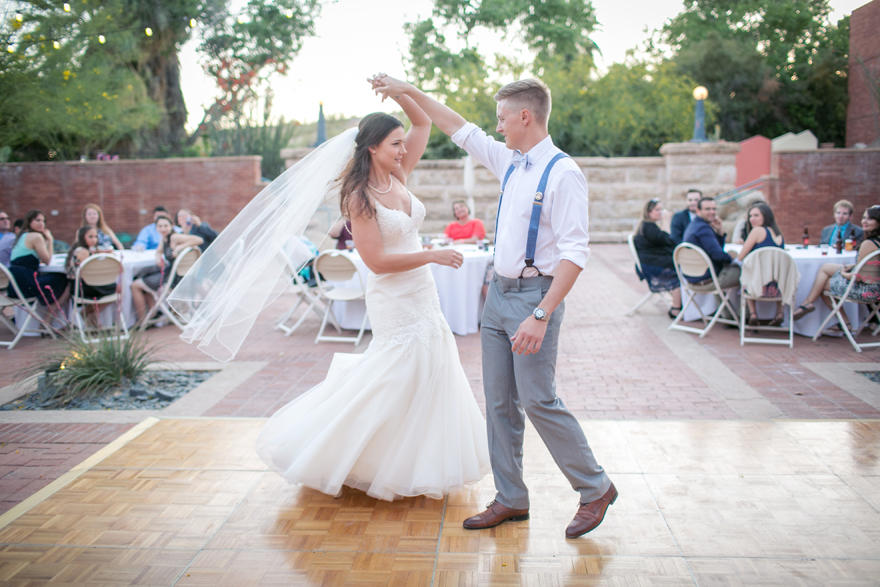 bride & groom share their first dance in an outdoor reception