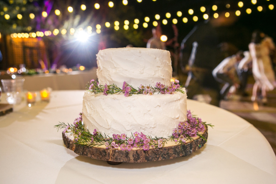 rustic wedding cake decorated with tiny flowers