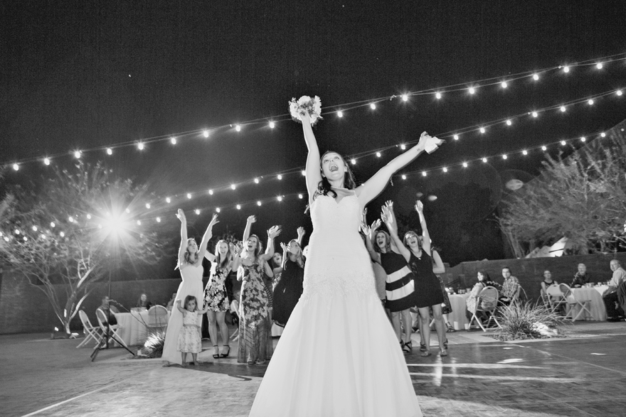 excited bride throws the bouquet