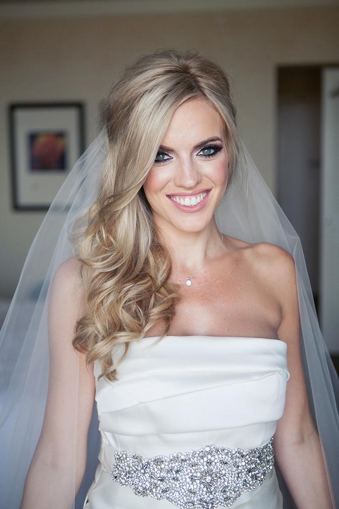 Beaming blonde bride in her wedding dress